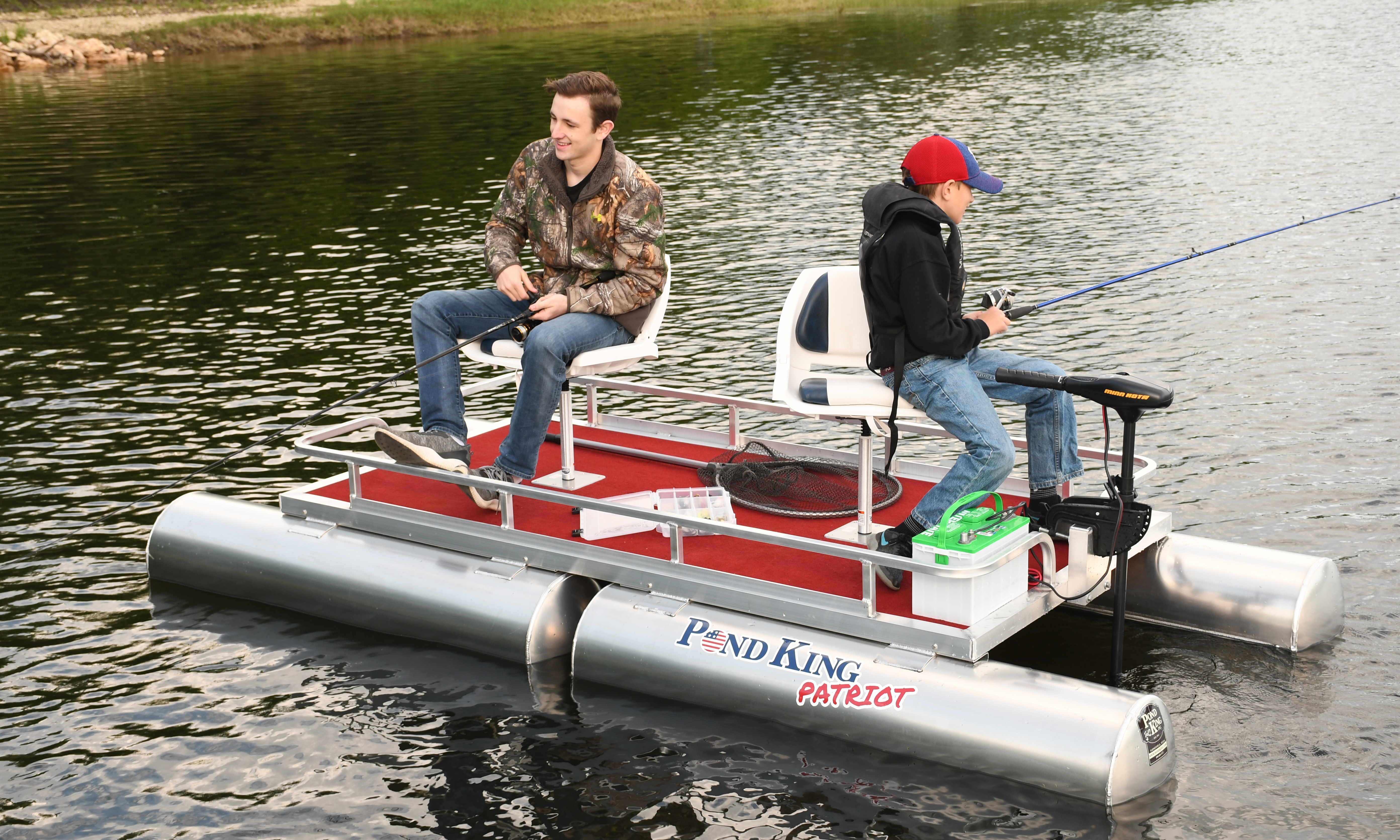 Two Kids Fishing on from an assembled Patriot Pontoon Boat Kit