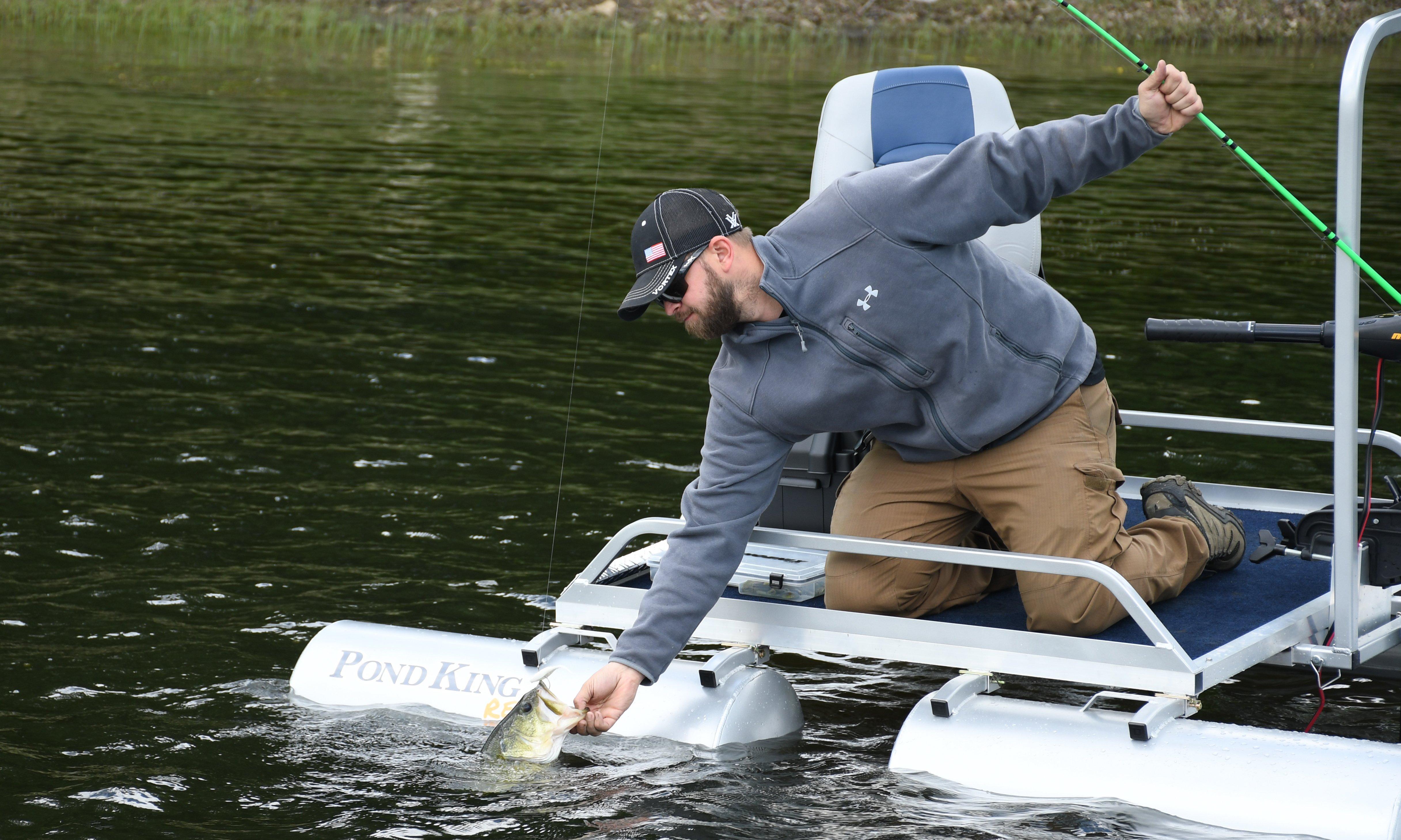 Landing a Bass from a Rebel Modular Mini Pontoon Boat