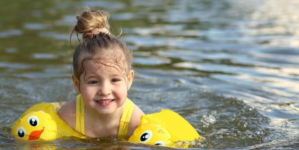 little-girl-swimming-in-pond