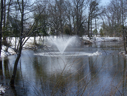 winter pond with fountain for aeration